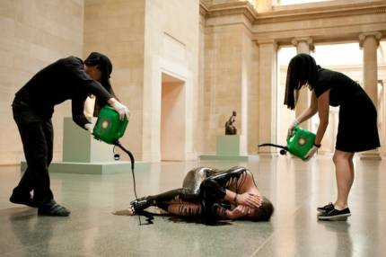 Artists from Liberate Tate performance at London's Tate Britain gallery at the anniversary of the BP oil spill in the Gulf of Mexico. Photo: IMMO KLINK © 2011